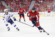 Evgeny Kuznetsov #92 of the Washington Capitals controls the puck against Ryan Callahan #24 of the Tampa Bay Lightning in the second period of Game Six of the Eastern Conference Finals during the 2018 NHL Stanley Cup Playoffs at Capital One Arena on May 21, 2018 in Washington, DC.