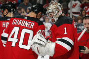 Michael Grabner #40 of the New Jersey Devils and Keith Kinkaid #1 of the New Jersey Devils celebrate after defeating the Tampa Bay Lightning 2-1 at the Prudential Center on March 24, 2018 in Newark, New Jersey.