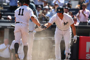 Brett Gardner #11 of the New York Yankees scores a run and celebrates with Matt Holliday #17 against the Tampa Bay Rays during the New York Yankees home Opening game at Yankee Stadium on April 10, 2017 in New York City.