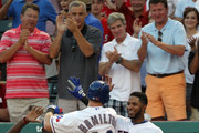 Josh Hamilton #32 of the Texas Rangers is congratulated by teammate Elvis Andrus #1 after hitting a solo home run against the Tampa Bay Rays on August 29, 2012 at the Rangers Ballpark in Arlington in Arlington, Texas.