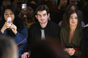 Conor Kennedy (C) and Danielle Bernstein attend the Taoray Wang front row during New York Fashion Week: The Shows at Gallery II at Spring Studios on February 9, 2019 in New York City.