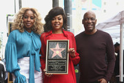 Mary J. Blige, Taraji P. Henson and John Singleton attend a ceremony honoring Taraji P. Henson with a star on The Hollywood Walk of Fame on January 28, 2019 in Hollywood, California.