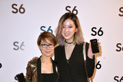 Younghee Lee (L)and Irene Kim attend the Paris Fashion Week Tasting Night with Galaxy featuring Brad Goreski, model Jessica Stam and Samsung's Executive Vice President of Global Marketing for Mobile Communications, Younghee Lee  at Four Seasons Hotel George V on March 7, 2015 in Paris, France.