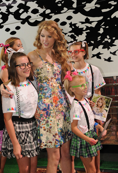 Taylor Swift Singer/Songwriter Taylor Swift autographs for 13 hours on the 13th. of June and plays with her band several for her fans during The CMA Music Festival on June 13, 2010 in Nashville, Tennessee.