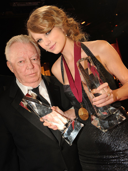 Taylor Swift BMI Icon Billy Sherrill and Taylor Swift with her awards for BMI Songwriter of the Year and Co Writer of BMI Song of the Year at the 58th Annual BMI Country Music Awards at BMI on November 9, 2010 in Nashville, Tennessee.