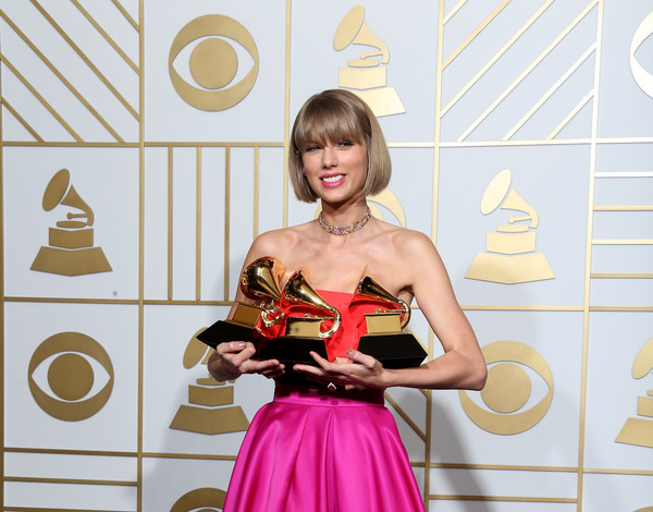 The 58th GRAMMY Awards - Press Room [best pop album,best music video,album of the year,yellow,pink,dress,fashion,red carpet,flooring,carpet,photography,costume,taylor swift,awards,room,staples center,press room,grammy awards,bad blood]