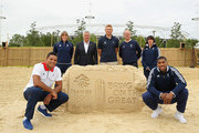 (L - R) Joe Joyce,  Kate Richardson Walsh BOA CEO Bill Sweeney, James Rodwell, Team GB Chef de Mission Mark England, Beth Tweddle and Anthony Joshua pose for a photo to celebrate one year to go until the Rio 2016 Olympic Games at Beach East, Queen Elizabeth Olympic Park on August 5, 2015 in London, England.