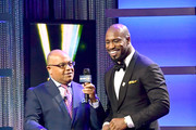 Mike Tirico  and Vernon Davis attend the Team USA Awards at the Duke Ellington School of the Arts on April 26, 2018 in Washington, DC.