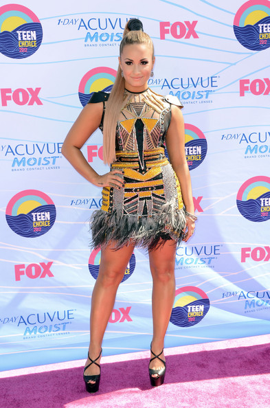 Singer/actress Demi Lovato arrives at the 2012 Teen Choice Awards at Gibson Amphitheatre on July 22, 2012 in Universal City, California.