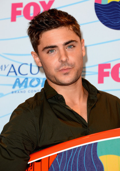 Actor Zac Efron poses with Choice Movie Actor award in the press room during the 2012 Teen Choice Awards at Gibson Amphitheatre on July 22, 2012 in Universal City, California.