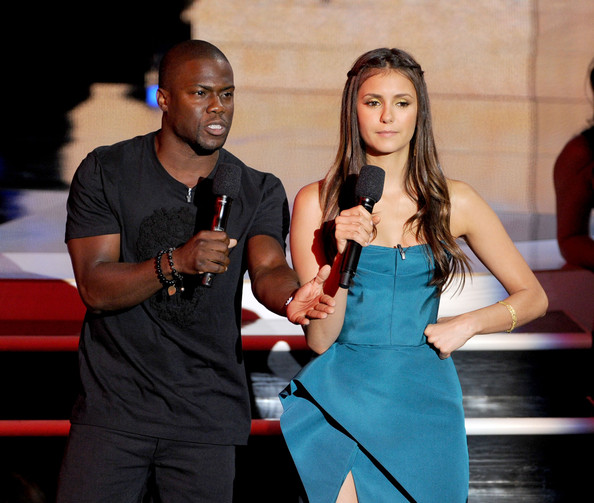 Actors Kevin Hart (L) and Nina Dobrev speak onstage during the 2012 Teen Choice Awards at Gibson Amphitheatre on July 22, 2012 in Universal City, California.
