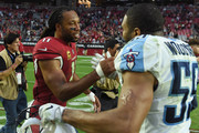 Larry Fitzgerald #11 of the Arizona Cardinals high fives Wesley Woodyard #59 of the Tennessee Titans after the NFL game at University of Phoenix Stadium on December 10, 2017 in Glendale, Arizona. The Arizona Cardinals won 12 - 7.