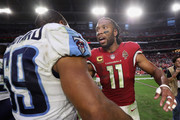 Wide receiver Larry Fitzgerald #11 of the Arizona Cardinals greets inside linebacker Wesley Woodyard #59 of the Tennessee Titans following the NFL game  at the University of Phoenix Stadium on December 10, 2017 in Glendale, Arizona. The Cardinals defeated the Titans 12-7.