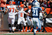 Johnny Manziel #2 of the Cleveland Browns celebrates a first quarter touchdown pass with John Greco #77 while playing the Tennessee Titans at FirstEnergy Stadium on September 20, 2015 in Cleveland, Ohio.