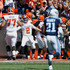 John Greco Photos - Johnny Manziel #2 of the Cleveland Browns celebrates a first quarter touchdown pass with John Greco #77 while playing the Tennessee Titans at FirstEnergy Stadium on September 20, 2015 in Cleveland, Ohio. - Tennessee Titans v Cleveland Browns