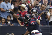 Will Fuller #15 and Chris Clark #74 of the Houston Texans celebrate a touchdown reception against the Tennessee Titans in the second quarter at NRG Stadium on October 1, 2017 in Houston, Texas.