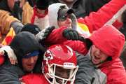 Receiver Dwayne Bowe #82 of the Kansas City Chiefs is congratulated by Chris Chambers #84 and fans as he jumps into the stands after making a 75 yard touchdown catch during the game against the Tennessee Titans on December 26, 2010 at Arrowhead Stadium in Kansas City, Missouri.