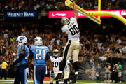 Jimmy Graham #80 of the New Orleans Saints celebrates a touchdown during a preseason game between the New Orleans Saints and the Tennessee Titans at Mercedes-Benz Superdome on August 15, 2014 in New Orleans, Louisiana.