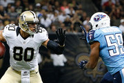 Jimmy Graham #80 of the New Orleans Saints runs against Wesley Woodyard #59 of the Tennessee Titans during a preseason game at Mercedes-Benz Superdome on August 15, 2014 in New Orleans, Louisiana.