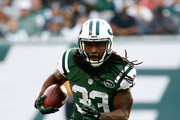 Chris Ivory #33 of the New York Jets carries the ball against the Tennessee Titans in the second quarter during their game at MetLife Stadium on December 13, 2015 in East Rutherford, New Jersey.