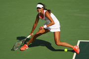 Ana Ivanovic of Serbia stretches to play a forehand against Carla Suarez Navarro of Spain in their first round match on Day 1 of the Rio 2016 Olympic Games at the Olympic Tennis Centre on August 6, 2016 in Rio de Janeiro, Brazil.