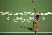 Ana Ivanovic of Serbia serves against Carla Suarez Navarro of Spain in their first round match on Day 1 of the Rio 2016 Olympic Games at the Olympic Tennis Centre on August 6, 2016 in Rio de Janeiro, Brazil.