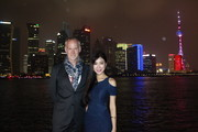 (L to R) Alan Taylor and Betty Zhou pose on a boat at the Bund to promote the Terminator Genisys release in China on August 20, 2015 in Shanghai, China.