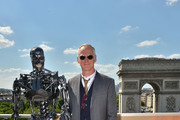 Director Alan Taylor poses with Endoskeleton during the France Photocall of 'Terminator Genisys' at the Publicis Champs Elysees on June 19, 2015 in Paris, France.