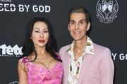 """Perry Farrell and Etty Lau Farrell attend Teton Gravity Research's """"Andy Iron's Kissed By God"""" World Premiere at Regency Village Theatre on May 2, 2018 in Westwood, California."""