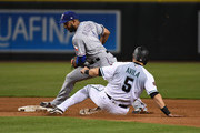 Alex Avila #5 of the Arizona Diamondbacks is forced out at second base by Elvis Andrus #1 of the Texas Rangers during the fourth inning at Chase Field on July 31, 2018 in Phoenix, Arizona.