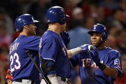 Elvis Andrus #1 of the Texas Rangers is congratulated by teammates Craig Gentry #23 and Josh Hamilton #32 on September 2, 2011 at Fenway Park in Boston, Massachusetts.