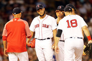 Eduardo Rodriguez #57 of the Boston Red Sox is taken out of the game in the sixth inning by Manager Alex Cora during a game against the Texas Rangers at Fenway Park on July 9, 2018 in Boston, Massachusetts.
