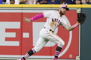 Derek Fisher #21 of the Houston Astros makes a catch on a line drive by Delino DeShields #3 of the Texas Rangers in the sixth inning at Minute Maid Park on May 13, 2018 in Houston, Texas.
