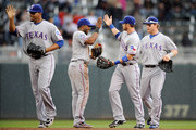(L-R) Nelson Cruz, Elvis Andrus, Craig Gentry and Josh Hamilton #32 of the Texas Rangers celebrate a win against the Minnesota Twins on April 15, 2012 at Target Field in Minneapolis, Minnesota. The Rangers defeated the Twins 4-3.