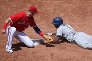 Elvis Andrus #1 of the Texas Rangers steals second base in the third inning during MLB game action as Troy Tulowitzki #2 of the Toronto Blue Jays applies the late tag at Rogers Centre on May 28, 2017 in Toronto, Canada.