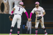 Carlos Correa #1 of the Houston Astros and Derek Fisher #21 celebrate after defeating the Texas Rangers 6-1 at Minute Maid Park on May 13, 2018 in Houston, Texas.