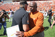 Head Coach Charlie Strong of the Texas Longhorns meets Head Coach Mike Gundy of the Oklahoma State Cowboys after the game October 1, 2016 at Boone Pickens Stadium in Stillwater, Oklahoma. The Cowboys defeated the Longhorns 49-31.