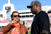 Actor Matthew McConaughey and quarterback Vince Young talk on the sidelines before the game between the Texas Longhorns and the USC Trojans at Los Angeles Memorial Coliseum on September 16, 2017 in Los Angeles, California.