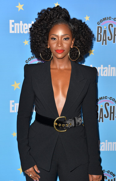 Entertainment Weekly Comic-Con Celebration - Arrivals [entertainment weekly comic-con celebration - arrivals,teyonah parris,hair,suit,clothing,hairstyle,pantsuit,fashion,premiere,formal wear,outerwear,electric blue,san diego,hard rock hotel,california,entertainment weekly comic-con celebration at float]