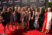 (L-R) Professional soccer players Heather OÂ'Reilly, Christine Rampone, Shannon Boxx, Becky Sauerbrunn, Julie Johnston, LoriChalupny, Whitney Engen, Amy RodRodriguez, Alyssa Naeher, Kelly OÂ'Hara, Ashlyn Harris, Ali Krieger and Megan Rapinoe attend The 2015 ESPYS at Microsoft Theater on July 15, 2015 in Los Angeles, California.
