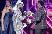 Actor Jessica Szohr (L) and NFL player Odell Beckham Jr. present the award to NBA player Donovan Mitchell onstage at The 2018 ESPYS at Microsoft Theater on July 18, 2018 in Los Angeles, California.