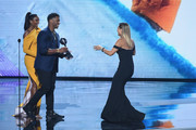 Olympic snowboarder Chloe Kim accepts the award for Best Female Athlete from singer Ciara and NFL player Russell Wilson  onstage at The 2018 ESPYS at Microsoft Theater on July 18, 2018 in Los Angeles, California.