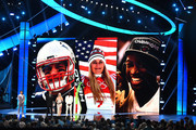 (L-R) Zachary Levi listens to Rob Gronkowski, Lindsey Vonn, and Dwyane Wade accept the Best Moment awards onstage during The 2019 ESPYs at Microsoft Theater on July 10, 2019 in Los Angeles, California.