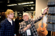 George Lowden and Ed Sheeran chatin the Lowden booth at the 2019 NAMM Show opening day at the Anaheim Convention Center on January 24, 2019 in Anaheim, California.