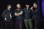 Jonny Buckland, Guy Berryman, Chris Martin and Will Champion of Coldplay accept their Best British Band Award at The Brit Awards 2012 at The O2 Arena on February 21, 2012 in London, England.
