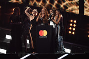 (EDITORIAL USE ONLY) (L-R) Fearne Cotton and Holly Willoughby present Perrie Edwards, Jesy Nelson, Jade Thirlwall and Leigh-Anne Pinnock of Little Mix with the award for Best British Single on stage at The BRIT Awards 2017 at The O2 Arena on February 22, 2017 in London, England.