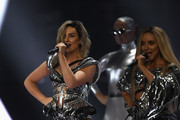 (EDITORIAL USE ONLY) Perrie Edwards and Jade Thirlwall of Little Mix perform on stage at The BRIT Awards 2017 at The O2 Arena on February 22, 2017 in London, England.
