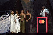 *** EDITORIAL USE ONLY IN RELATION TO THE BRIT AWARDS 2018 *** (L-R) Perrie Edwards, Leigh Anne Pinnock, Jesy Nelson and Jade Thirlwall of Little Mix present Stormzy with the Best British Male Solo Artist award at The BRIT Awards 2018 held at The O2 Arena on February 21, 2018 in London, England.