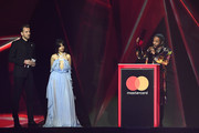 *** EDITORIAL USE ONLY IN RELATION TO THE BRIT AWARDS 2018 *** Harry Kane and Camilla Cabilo present Kendrick Lamar with the International Male Solo Artist, onstage at The BRIT Awards 2018 held at The O2 Arena on February 21, 2018 in London, England.