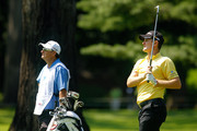 Justin Rose of England and his caddie Mark Fulcher watch Rose's tee shot on the first hole during the first round of The Barclays at the Ridgewood Country Club on August 26, 2010 in Paramus, New Jersey.